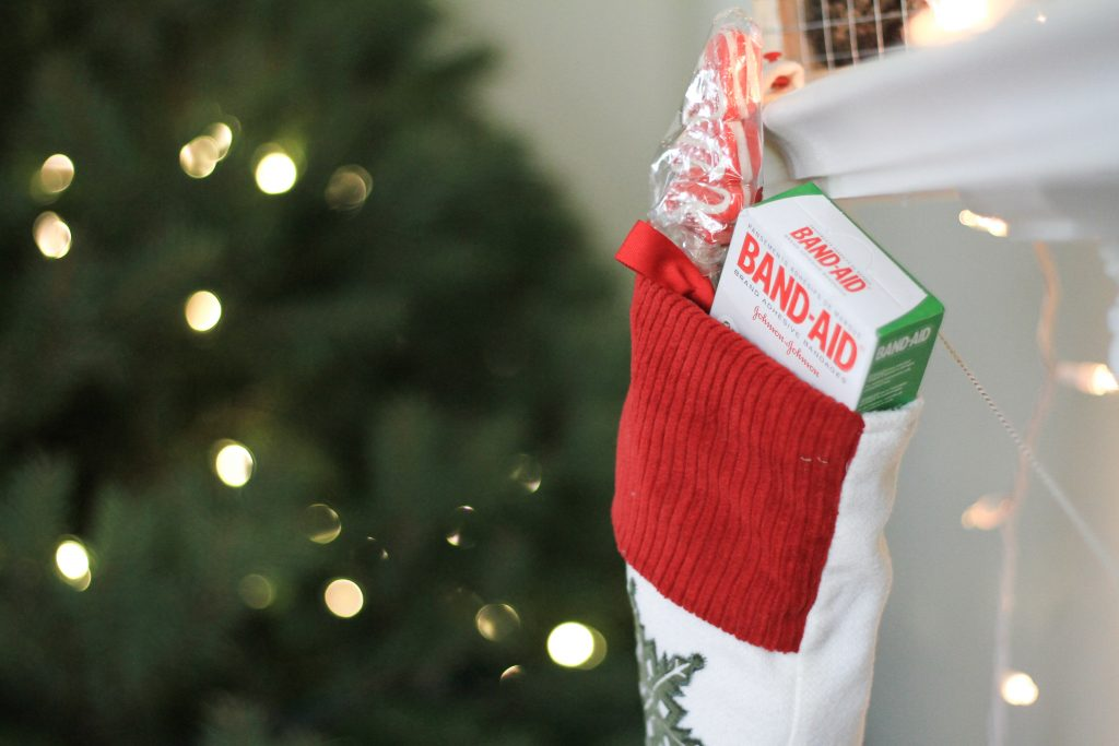home away from home stockings home for the holidays mom blog dad blog traveling family travel wellness band aid stpcking stuffing a stocking 20172018 Virginia Christmas early learning homeschooling mommy blogger zen living happy holidays South America Europe Asia mom life mom of boys boy mom