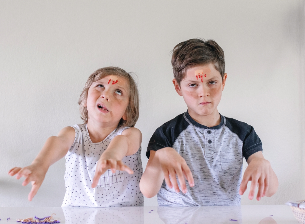 kids with some zombie makeup on and acting like zombies in Zo Zo Zombie